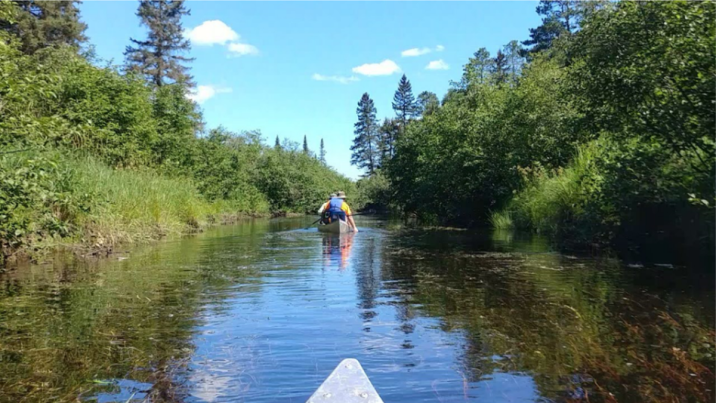 Paddling down a small river in the BWCAW Photo: Allison Nodurft