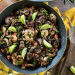 This Haitian style salt-cured pork and shrimp paella is packed with amazing flavors and enhanced with our famous local mushroom, djdondjon. A must try. | tchakayiti.com