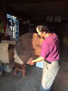 Nannuo Mountain teamaster Li Shulin with his small batch fermented shu pu er.