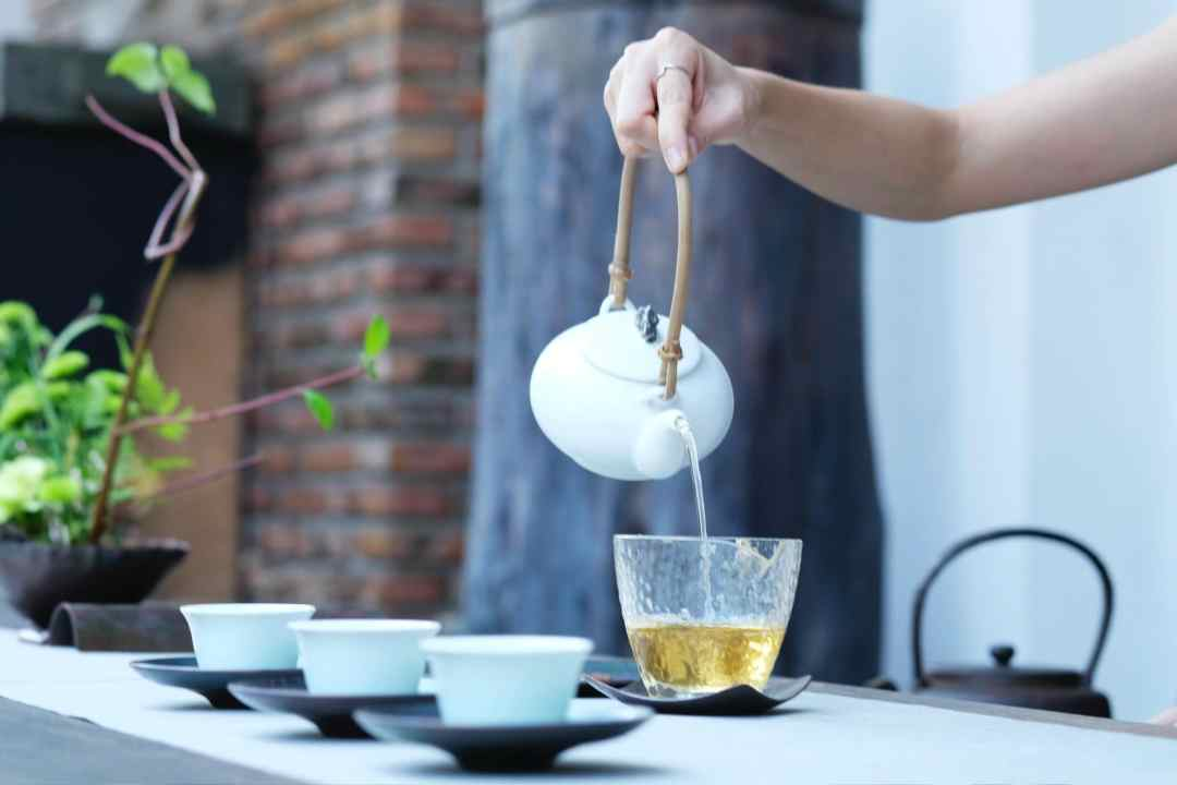10 Tea Experiences Around the World You Shouldn't Miss - Photo of someone pouring tea into a pitcher