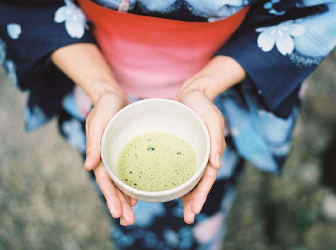 10 Tea Experiences Around the World You Shouldn't Miss - Photo of green tea in someone's hands