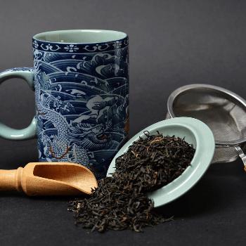 black tea, scoop, strainer teacup