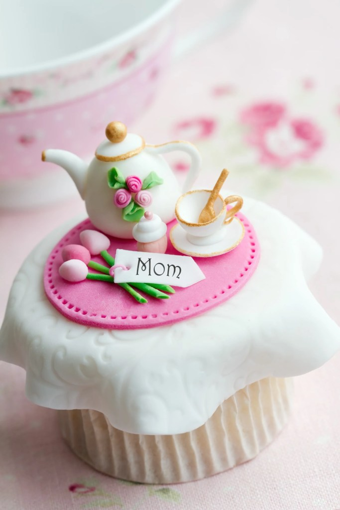 cupcake decorated with tiny tea set for mother's day