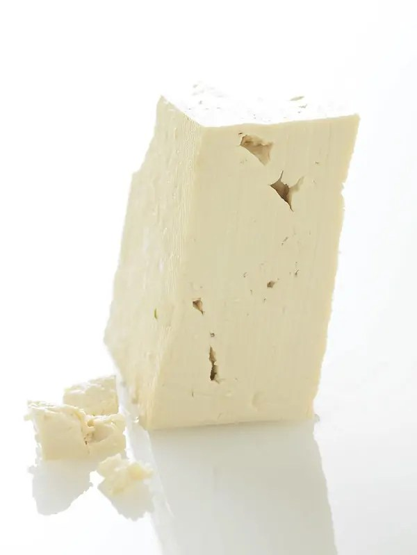 A block of tofu standing up on its end