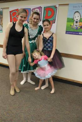 TCSD dancers with a young participant at the Summer Reading Program at Bloomington Public Library. (June 2014)