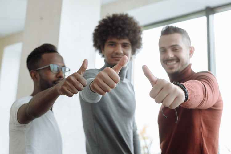 men putting a thumbs up