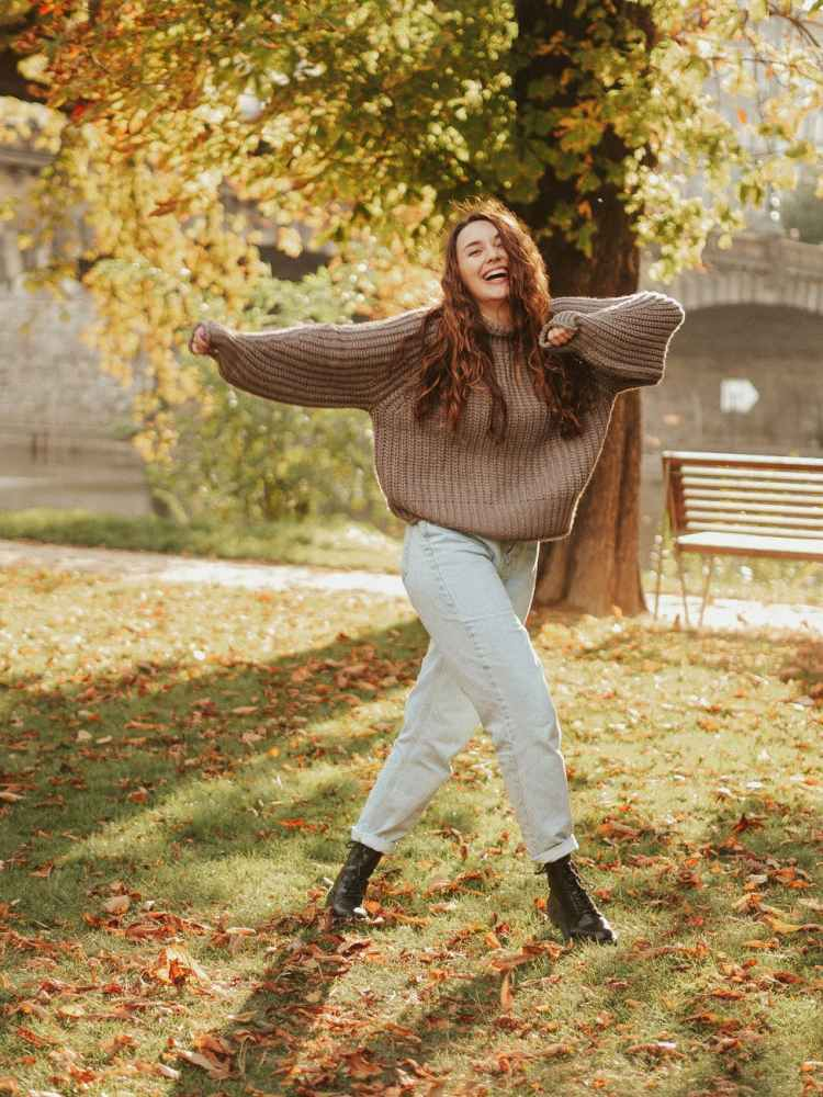 young woman posing in autumn weather
