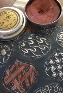 You can add color and patinas using assorted Gilder's Pastes. Just rub them directly on the metal with your finger
