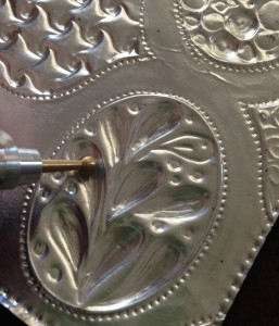 "On the back and over the suede ""puff"" some areas of your design by embossing with the sphere of the ""Cup and Ball"" tool"