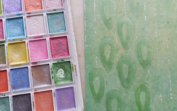 Paint the larger raindrops with metallic watercolors.