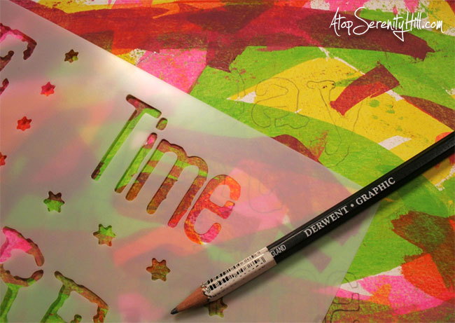 Colorful stenciling against a black background • Consie Sindet for The Crafter's Workshop #artjournaling #stencils #mixedmedia