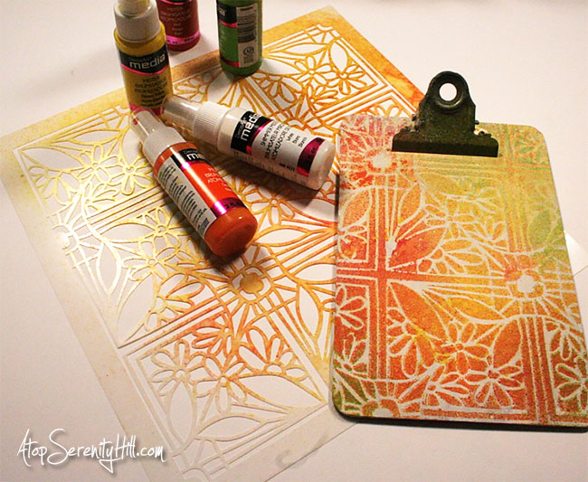 Faux Stained Glass Clipboard using a stencil from The Crafter's Workshop, some spray inks and dimensional paint! AtopSerenityHill.com #stainedglass #stencil #clipboard
