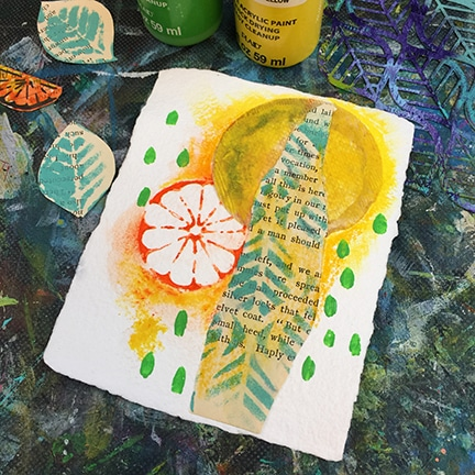 Green acrylic painted pattern over watercolor and ephemera