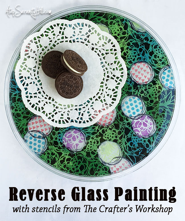 Try reverse glass painting using stencils from The Crafter's Workshop! • AtopSerenityHill.com #stencils #glasspainting #homedecor