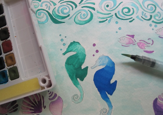 Add watercolor wash to the background of the journal page. Lefko
