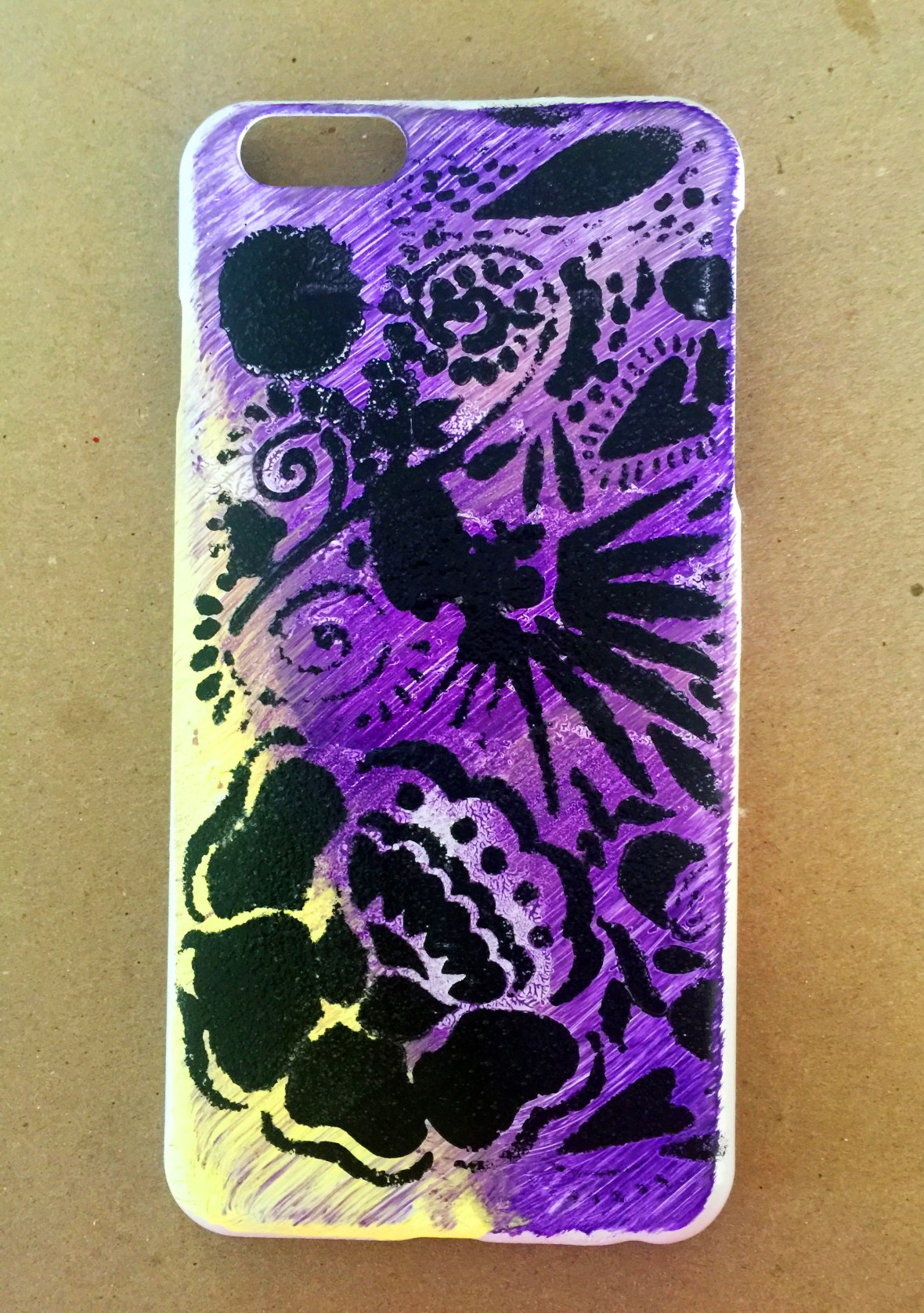 Stenciled phone case using primer, gesso, paint and gloss