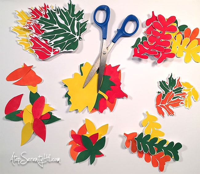 Fall leaves paper garland using stencils from The Crafter's Workshop • AtopSerenityHill.com • #stencil #falldecor #garland