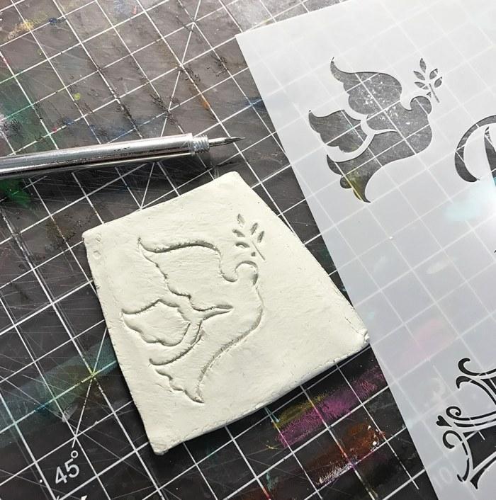 Dove Stencil Traced in Clay