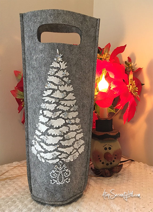 Wine bottle gift bag made using fluffy modeling paste and a stencil from The Crafter's Workshop. Perfect for holiday gift giving! • AtopSerenityHill.com