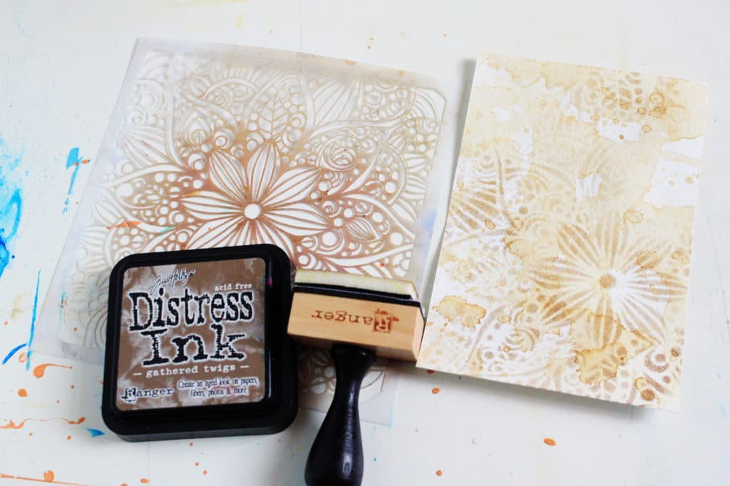 coffee-colored background with distress ink