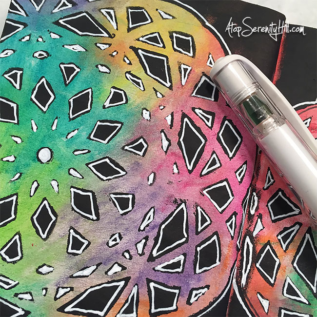 Easy rainbow mandala using a stencil from The Crafter's Workshop, Inktense pencils and doodling! A great addition to my art journal. AtopSerenityHill.com