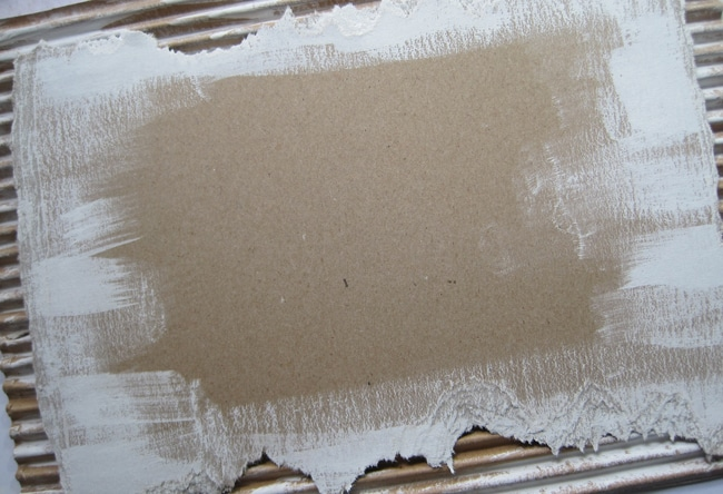 Dry brush cardboard with TCW white gesso LEFKO