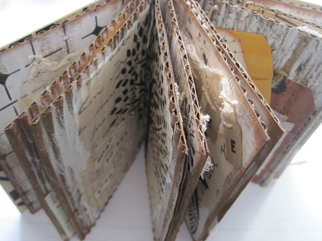 Open art journal with cardboard pages LEFKO