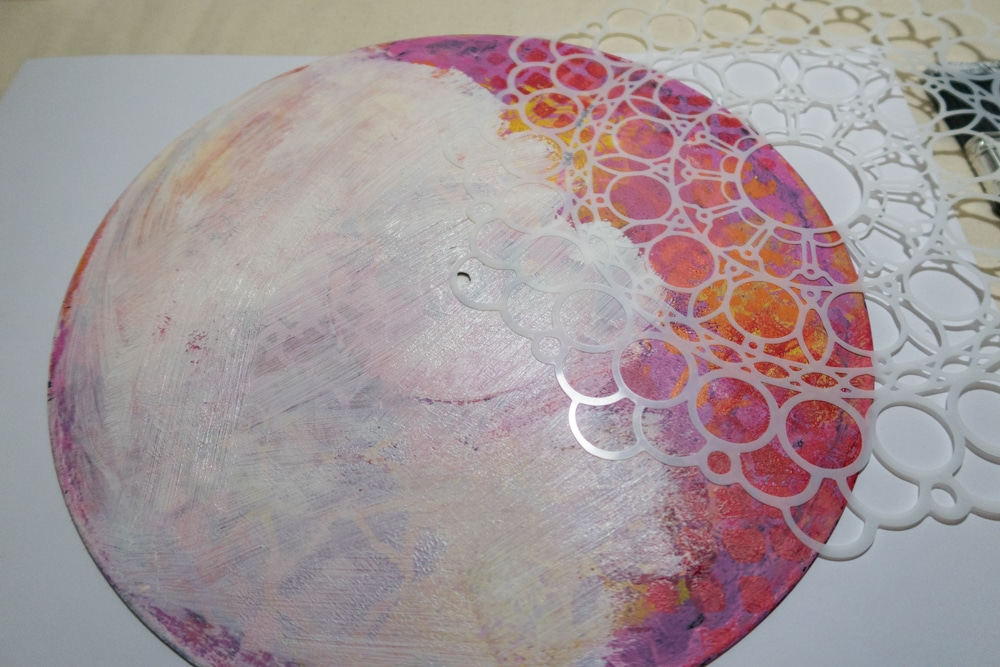 Paint 3/4 of record with white gesso