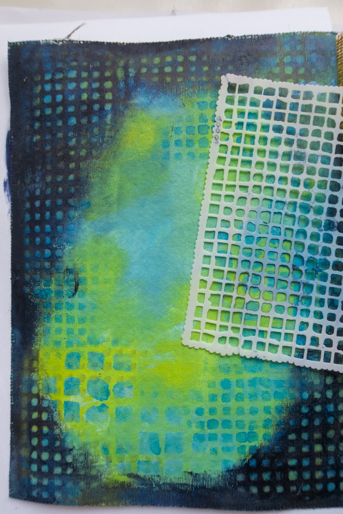 Stencil page edge with a dark coloured acrylic paint & remove colour through stencil