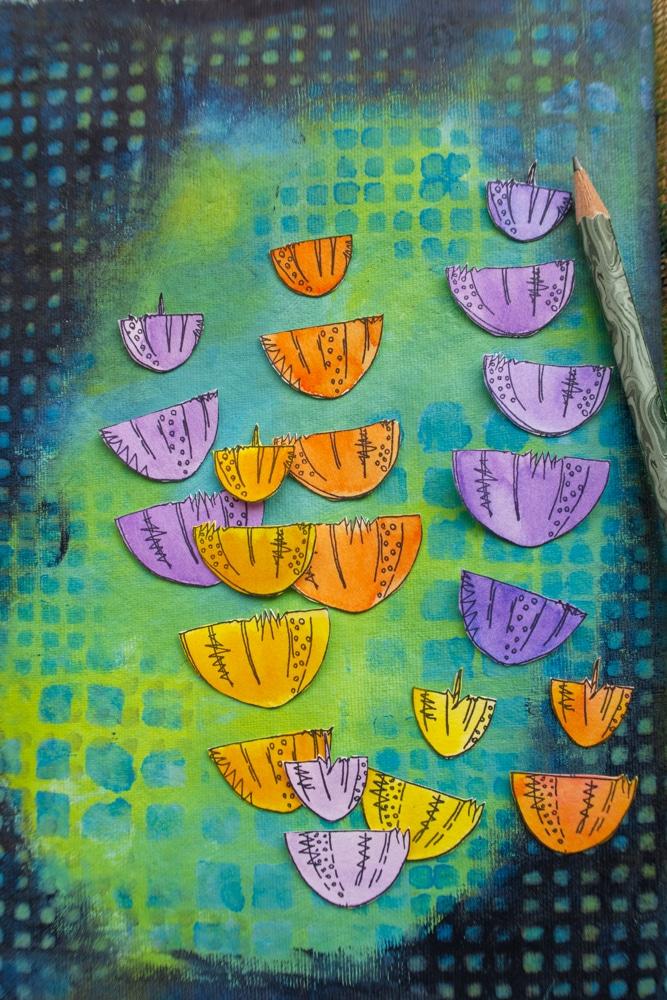Arrange flower heads on page in a pleasing manner