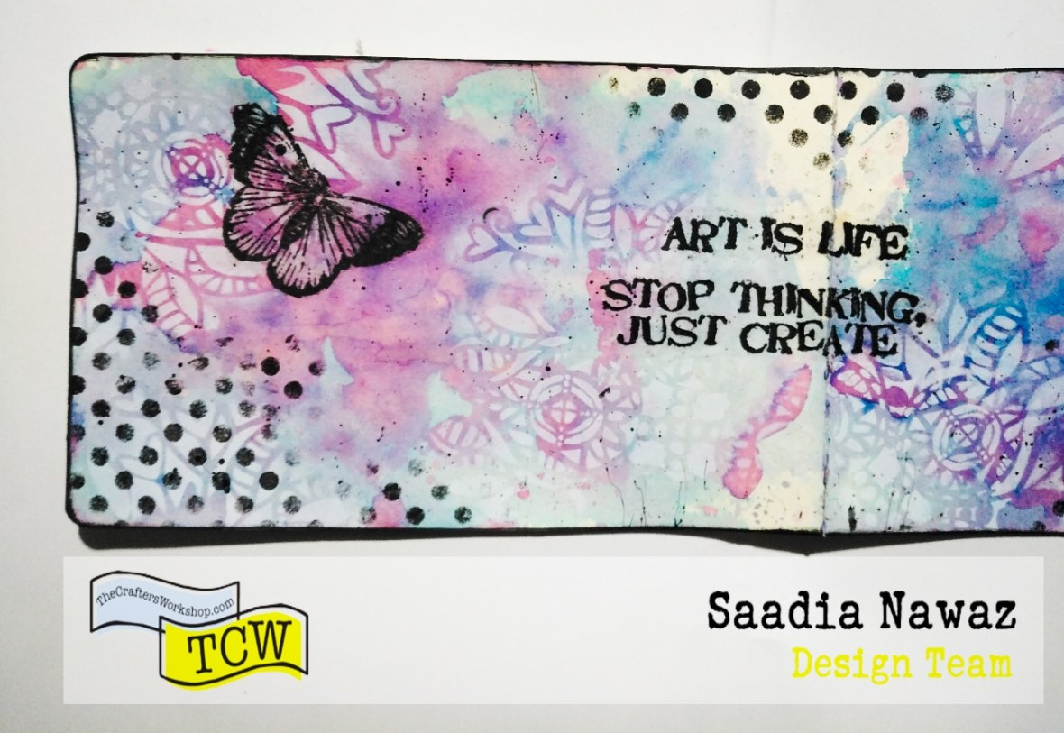 Art journal spread with acrylic paints, stencils, ink sprays and Rubber stamps