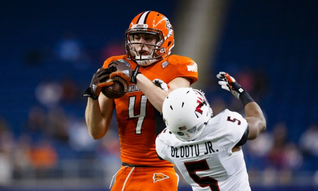 Dec 5, 2014; Detroit, MI, USA; Bowling Green Falcons wide receiver Gehrig Dieter (4) makes a catch over Northern Illinois Huskies cornerback Mayomi Olootu (5) in the second quarter at Ford Field. Mandatory Credit: Rick Osentoski-USA TODAY Sports