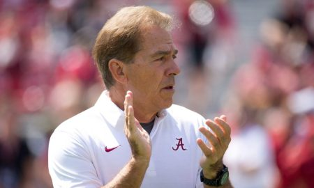 Alabama football head coach Nick Saban clapping at a game in 2017