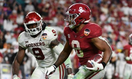 Josh Jacobs (No. 8) runs with the football for Alabama versus Oklahoma in 2018 CFP semifinal