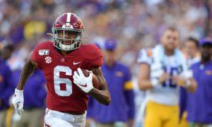 DeVonta Smith (No. 6) runs the ball for a touchdown in Alabama's 2019 game versus LSU