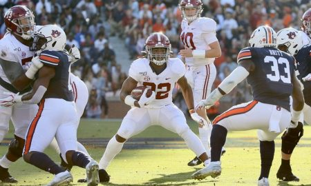 Alabama running back Najee Harris carries the football against the Auburn Tigers