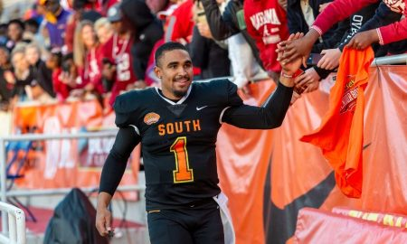 Jalen Hurts high gives fans following the Senior Bowl