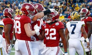 Najee Harris celebrates touchdown against Michigan