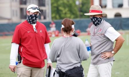 Nick Saban talking to assistants at Alabama fall practice