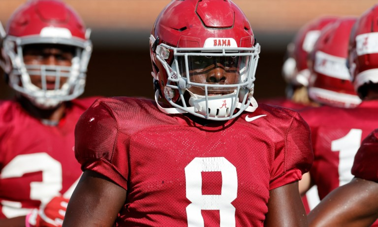Christian Harris working with inside linebackers at Alabama fall practice