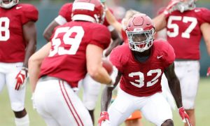 Dylan Moses shapes up for a tackle during Alabama's practice