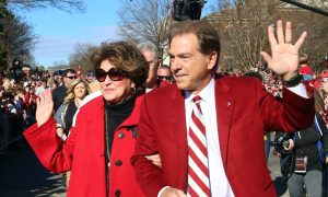 Nick Saban and Miss Terry wave to fans during national championship parade