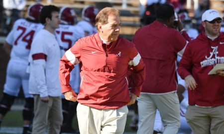 Nick Saban walks the sidelines during Alabama vs Mississippi State