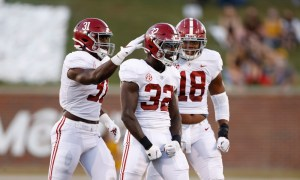 Will Anderson (No. 31) celebrates a sack with Dylan Moses and LaBryan Ray versus Missouri