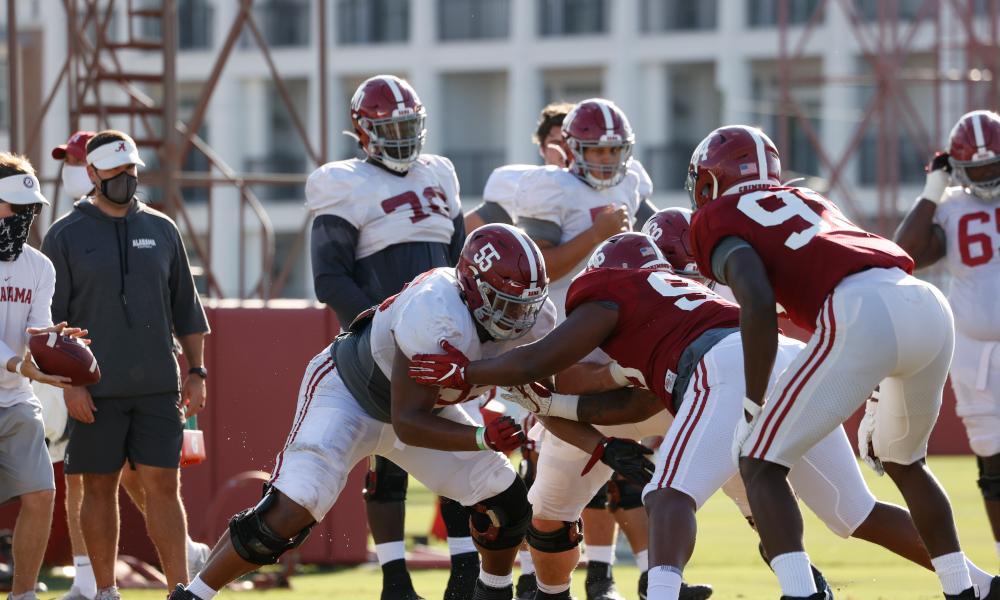 Emil Ekiyor blocking for Alabama during 2020 practice