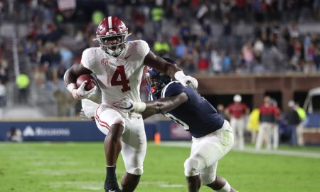 Brian Robinson runs the ball for Alabama versus Ole Miss