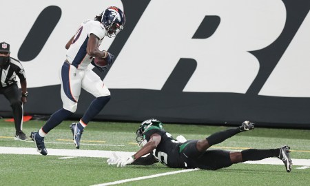 Jerry Jeudy (No. 10) of Denver Broncos breaks a tackle and scores versus New York Jets