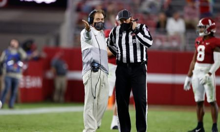 Nick Saban talks to the official