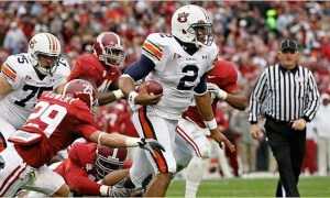 Cam Newton runs the ball against Alabama in 2010 Iron Bowl
