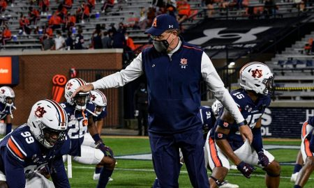 Gus Malzahn talks with the team prior to playing Tennessee